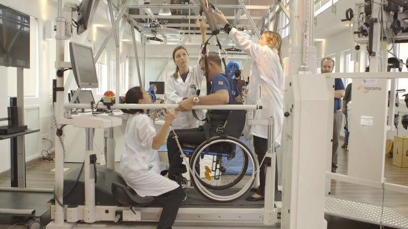 SAO PAULO, BRAZIL - Therapists helping Eric be lifted out of his wheel chair.